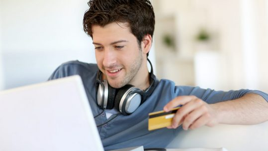 Modern man doing shopping online from home