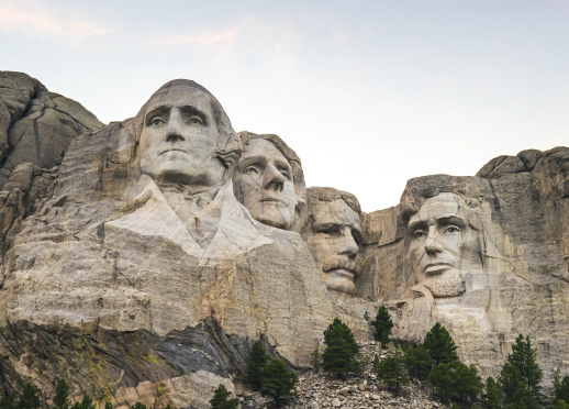 Mount Rushmore monument faces on a bright sunny day