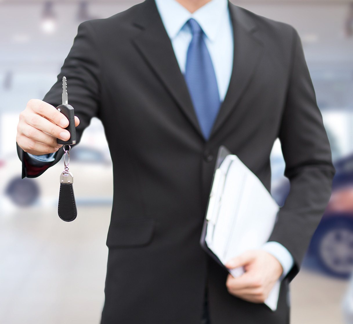 close up of businessman or salesman giving car key